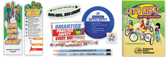 Bicycle safety awareness educational tools. flashing reflector lights, bracelets, bookmarks, pencils.